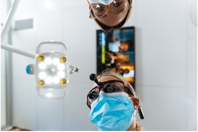 A Dentist and assistant